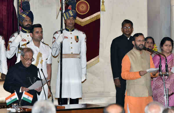 President Pranab Mukherjee administering the oath as Cabinet Minister to Prakash Javadekar, at a Swearing-in Ceremony, at Rashtrapati Bhavan, in New Delhi on July 05, 2016