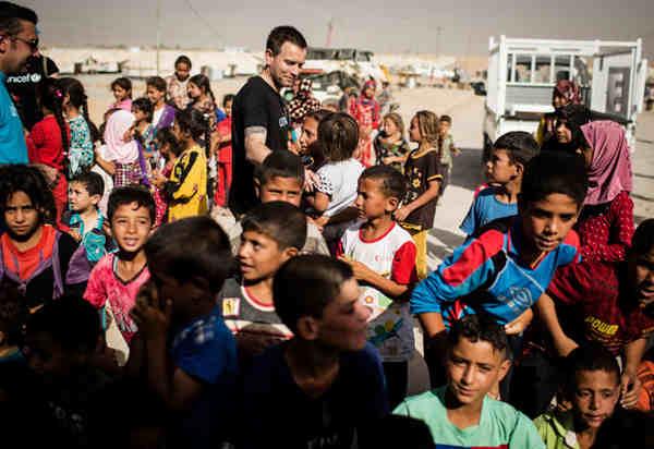 Unicef Ambassador Ewan McGregor meets displaced children at the Debaga IDP camp in northern Iraq on July 28, 2016