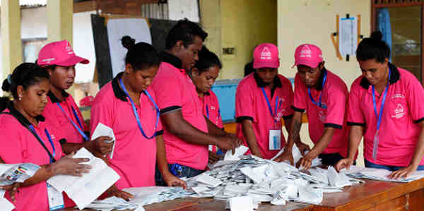 Polling officers tally votes after ballots were cast in Timor-Leste's parliamentary elections (2012). UN Photo / Martine Perret