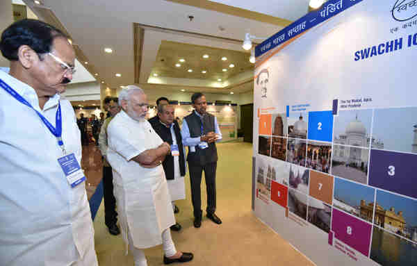 Narendra Modi watching the exhibition on 'Sanitation', at the inaugural ceremony of the INDOSAN (India Sanitation Conference), in New Delhi on September 30, 2016