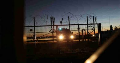 An Israeli Security Forces vehicle lights a gate in the security fence that separates farmers in the Biddu enclave from their land in the Seam Zone, which is the land between the 1949 Armistices Line and the West Bank Barrier. UN Photo: Alaa Ghosheh / UNRWA Archives