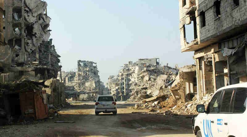 UN vehicles travel along a road lined with remnants of destroyed buildings, Homs, Syria. (file) Photo: UNICEF / UNI178367/ Tiku (file photo)
