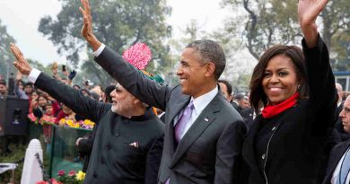 President Barack Obama and First Lady Michelle Obama wave to the crowd at the Rajpath saluting base following the Republic Day Parade in New Delhi, India, Jan. 26, 2015. (Official White House Photo by Pete Souza)