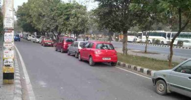 Cars parked on the roads of Delhi block the flow of traffic which can be hazardous. Photo by Rakesh Raman. Click the photo to read the story.