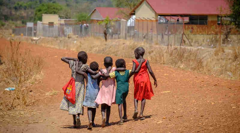 Refugee children walk home together after school in Nyumanzi refugee settlement. With thousands of new arrivals fleeing to Uganda every day, South Sudan is now AfricaÕs largest refugee crisis and the worldÕs third after Syria and Afghanistan Ð with less attention and chronic levels of underfunding. Photo: UNICEF