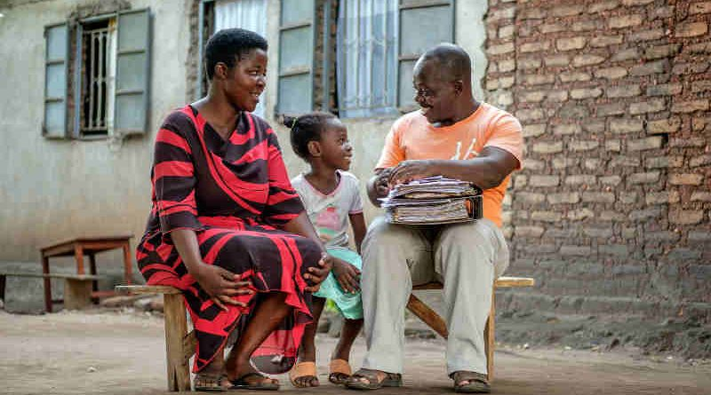 Seven-year-old Vera Edna (centre) sits with her father Edward (right) and her mother Annette in Kasese, western Uganda, Saturday 25 March 2017. Photo: UNICEF