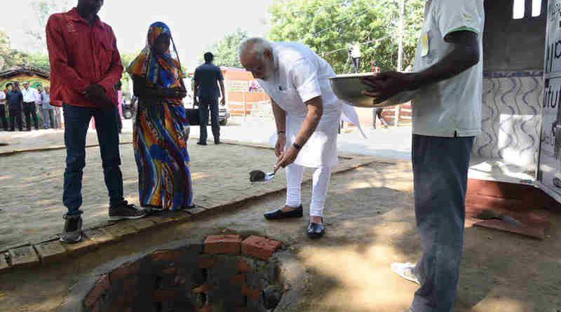Narendra Modi doing shramdan for the construction of a twin pit toilet, at Village Shahanshahpur, Varanasi, Uttar Pradesh on September 23, 2017