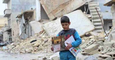 On 16 January 2017 in the Syrian Arab Republic, a child carries manuals distributed by UNICEF volunteers in the area following an informative session on identifying and reporting unexploded objects in Al- Sakhoor neighbourhood of East Aleppo.