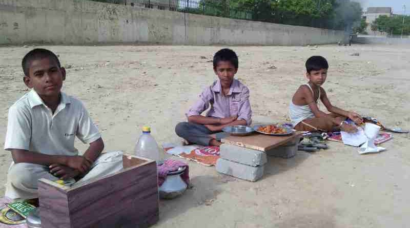 As school education is bad, young children are forced by parents to sell eatables outside a school building in New Delhi, India. Click the photo to know the details. Photo: Rakesh Raman / RMN News Service