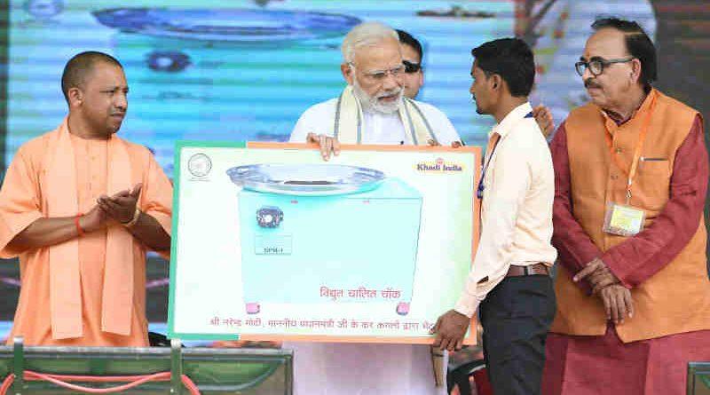 Narendra Modi at the inauguration of the various development projects, in Varanasi, Uttar Pradesh on September 18, 2018. The Chief Minister of Uttar Pradesh, Yogi Adityanath is also seen.