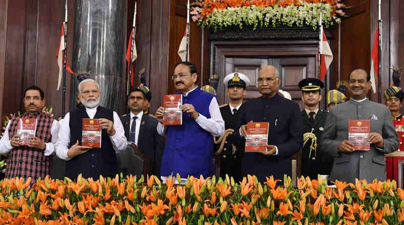 The President, Ram Nath Kovind, the Vice President, M. Venkaiah Naidu, the Speaker Lok Sabha, Om Birla, the Prime Minister, Narendra Modi and the Union Minister for Parliamentary Affairs Pralhad Joshi during the special session of Parliament to commemorate the 70th Constitution Day in New Delhi on November 26, 2019. Photo: PIB