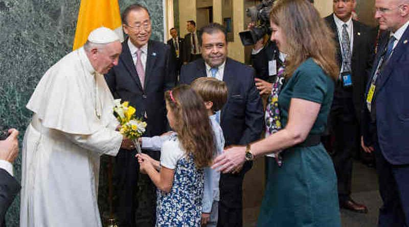 Pope Francis is welcomed by Secretary-General Ban Ki-moon and receives flower bouquets from children of UN staff members at the start of his visit to UN Headquarters (file photo). UN Photo / Mark Garten