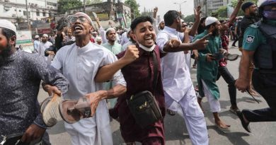 Protest against PM Modi's visit outside Dhaka's Baitul Mokarram mosque in March 2021. Demonstrators raised their shoes in their hands to register their anger against Modi. Photo: Mahmud Hossain Opu / Al Jazeera
